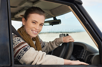Buy stock photo Portrait of an attractive young woman driving a car off road