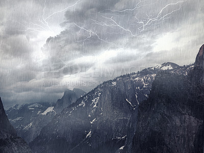Buy stock photo Shot of a mountain landscape enveloped in a storm