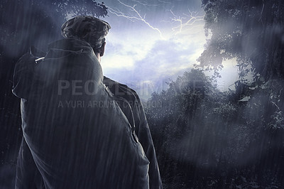 Buy stock photo Cropped shot of a hiker watching a thunderstorm over a mountain through a clearing in the forest