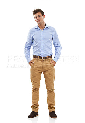 Buy stock photo Portrait of a handsome young man standing in a studio with his hands in his pockets