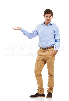 Buy stock photo Portrait of a handsome young man in a studio holding out one hand to the side