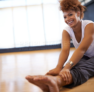 Buy stock photo Shot of a young woman dancer stretching on the floor