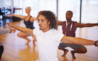 Buy stock photo Shot of a group of young dancers squatting in a dance studio