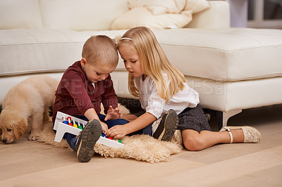 Buy stock photo Two young children playing with an abacus