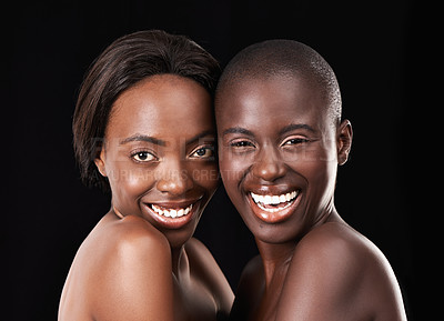 Buy stock photo Two beautiful african women standing together against a black background