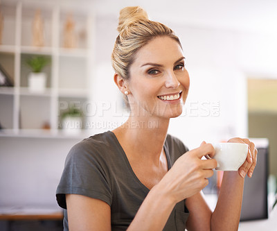 Buy stock photo A happy young businesswoman smiling at the camera as she