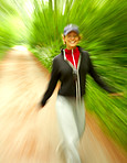 Woman running with motion blur.