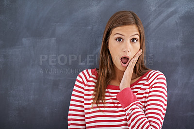 Buy stock photo Portrait of a young woman looking shocked