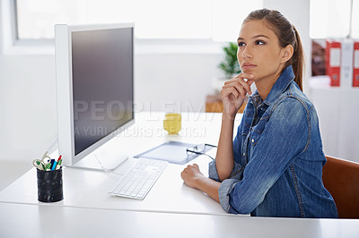Buy stock photo Shot of a young sitting thoughtfully at her desk