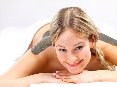 Buy stock photo Portrait of a beautiful lady getting mud skin treatment at the day spa