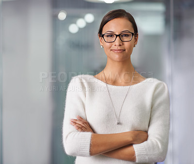 Buy stock photo Cropped portrait of a young businesswoman standing in an office