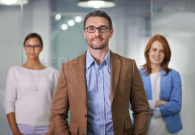 Buy stock photo Portrait of a businessman standing with his colleagues