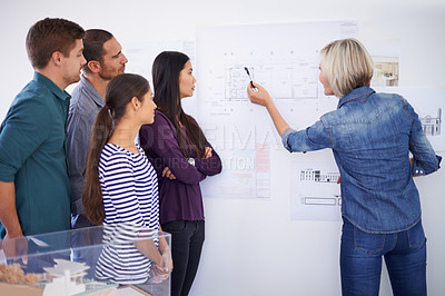 Buy stock photo Cropped shot of a group of architects discussing plans