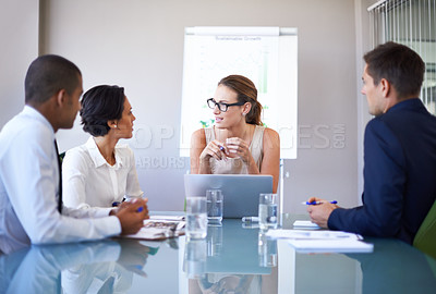 Buy stock photo A group of businesspeople having a meeting in a boardroom