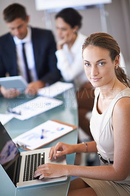 Buy stock photo Shot of a businesswoman during a meeting with her colleagues