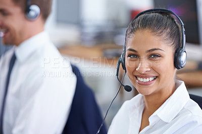 Buy stock photo Shot of a young woman wearing a headset