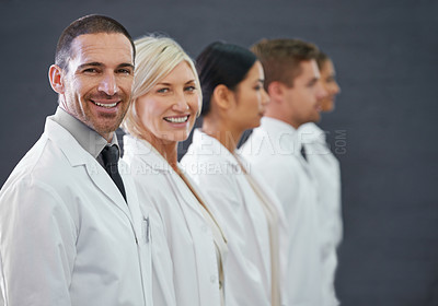 Buy stock photo Cropped shot of a group of doctors standing in a row