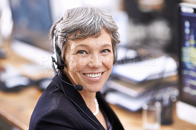 Buy stock photo Shot of an mature female call center representative wearing a headset