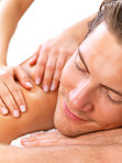 Female hands massaging young happy man