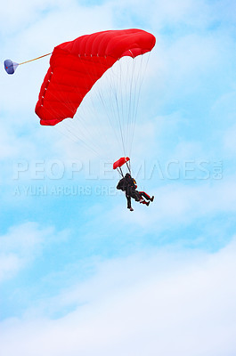 Buy stock photo A parachutist in the air. Blue sky background
