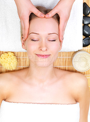 Buy stock photo Massaging a young female at the day spa. Portrait of a pretty young girl getting a massage at the day spa