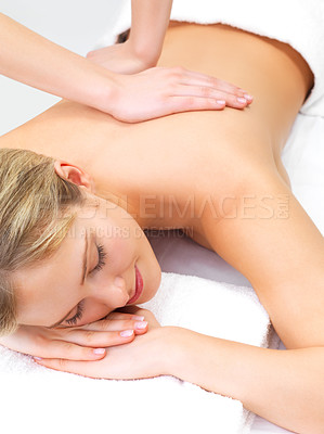Buy stock photo Massage therapy and hands massaging - Portrait of a pretty young girl getting a massage at the day spa