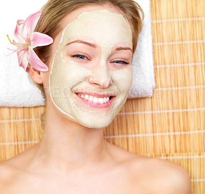 Buy stock photo Smiling young woman wearing facial mask, getting a beauty treatment.