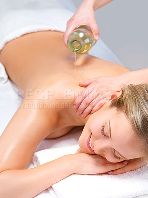 Buy stock photo Young female at the day spa. Portrait of a pretty young girl getting a massage at the day spa