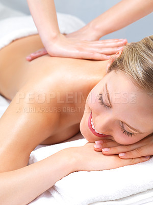Buy stock photo A beuatiful woman smiling while receiving a back massage at a spa