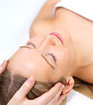 Hands massaging female face at the spa