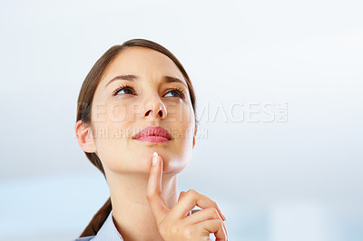 Buy stock photo Closeup of thoughtful businesswoman looking up - copyspace