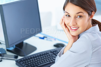 Buy stock photo Closeup of cute young female executive sitting at table and smiling