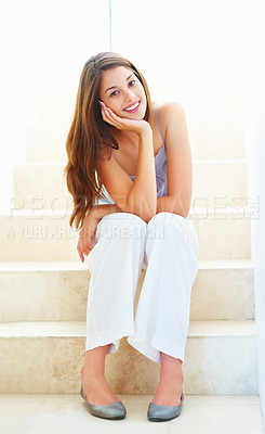 Buy stock photo Full length of an attractive young woman sitting on stairs and smiling