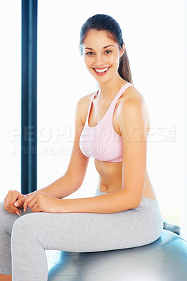 Buy stock photo Portrait of beautiful young woman sitting on pilates ball and smiling