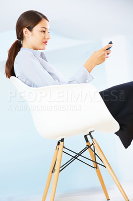 Buy stock photo Young business woman sitting on chair using cellphone