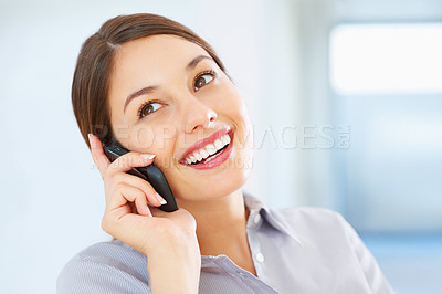 Buy stock photo Closeup of happy business woman talking on cellphone and looking away