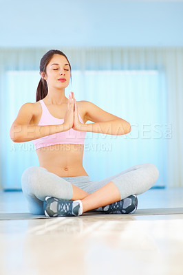Buy stock photo A young girl sitting in lotus position and meditating