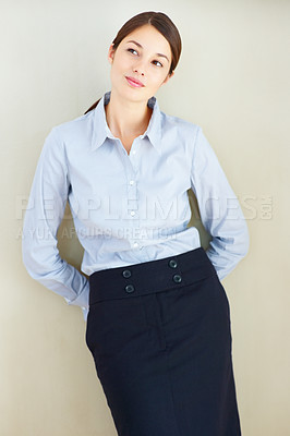 Buy stock photo Cute thoughtful business woman standing against wall and looking away