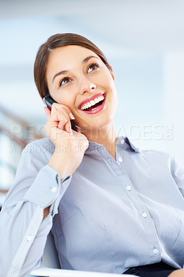 Buy stock photo Portrait of cute business woman sitting on chair and having friendly conversation on cellphone