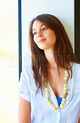 Buy stock photo Thoughtful young woman wearing beads and looking away