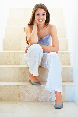 Buy stock photo Full length of beautiful young female sitting relaxed on the staircase