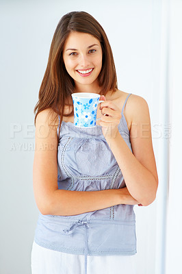 Buy stock photo Portrait of beautiful young woman holding coffee cup and smiling