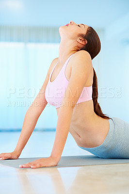 Buy stock photo Young woman in the upward facing yoga position
