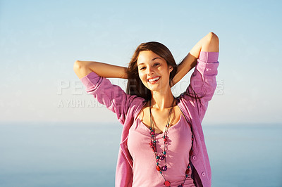 Buy stock photo Portrait of smiling young woman with hands behind head