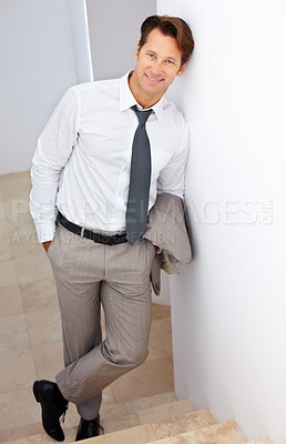 Buy stock photo Portrait of a confident young businessman standing on staircase