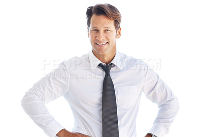 Buy stock photo Portrait of a smart young businessman standing with his hands on waist against white background