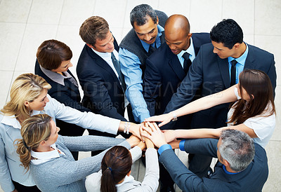 Buy stock photo Top view of executives with their hands together in circle