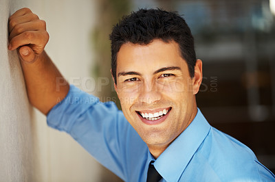 Buy stock photo Closeup of handsome executive leaning against wall