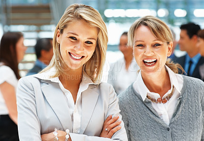 Buy stock photo Closeup of female executives smiling with colleagues in background