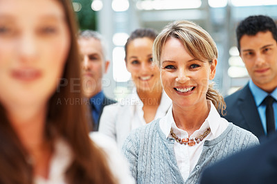 Buy stock photo Focus on female executive amongst group